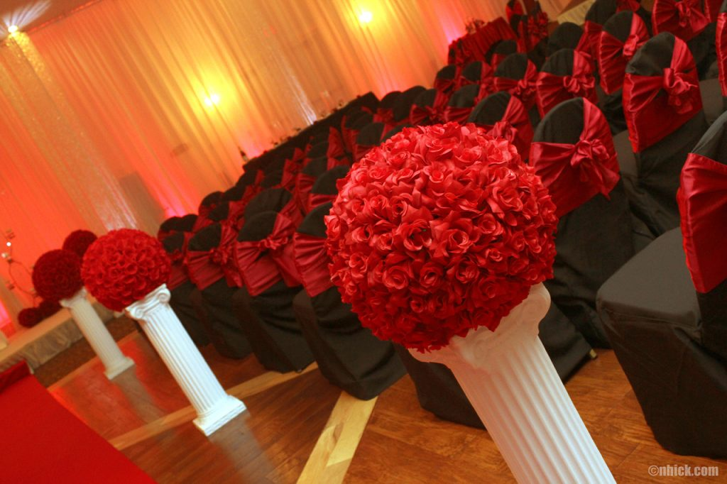 black and red themed hall setup at the Bayanihan Arts and Events Center for a wedding ceremony and reception in Tampa, Florida.