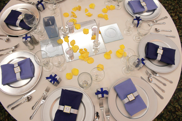 Blue and yellow theme hall setup at the Bayanihan Arts and Events Center as a wedding and reception venue in Tampa .